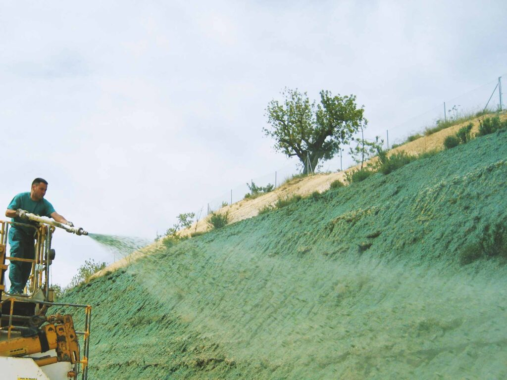 Example of Grass Seeding by man on lift doing Hydroseeding